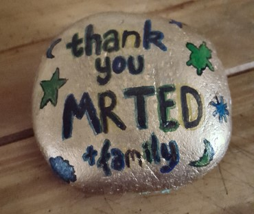 A painted stone presented to Mr Ted and his family as a thank you.