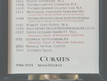 A photograph of the board at St Thomas' which lists the vicars who have presided.